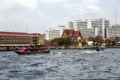 Excursion and pleasure boats sail on Chao Phraya river in Bangkok Royalty Free Stock Photo