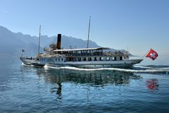 Excursion ship and people in the pier on Geneva Lake in Montreux Stock Photo