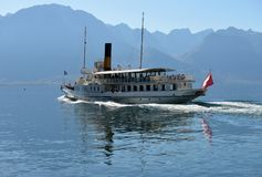 Excursion ship and people in the pier on Geneva Lake in Montreux. Swiss Riviera. Montreux Switzerland - October 12 2017 Royalty Free Stock Images