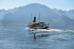 Excursion ship and people in the pier on Geneva Lake in Montreux Royalty Free Stock Photos