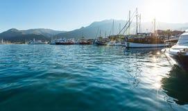 Excursion ships in bay (Greece, Lefkada). Excursion ships and tallships in bay (Nydri, Greece, Lefkada Stock Photos