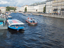 Excursion ships in the river of Fontanka. The view from Anichkov bridge in St. Peters Royalty Free Stock Photo