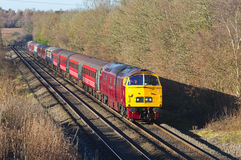 Excursion special. BEACONSFIELD, UK - DECEMBER 13: A vintage class 52 Western loco heads toward London with a passenger excursion train special on December 13 Royalty Free Stock Photos