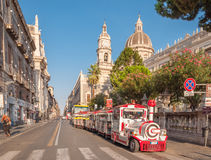 Excursion steam train in the background of the Cathedral in Catania Royalty Free Stock Photography