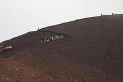 Excursion on stromboli. Group of hikers on stromboli stop for a break before you get to the middle Royalty Free Stock Photo