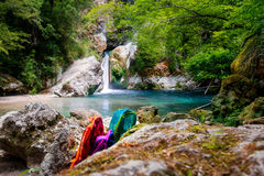 Excursion to the waterfall. Three backpacks between rocks Stock Images