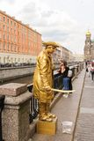 Live sculpture of filibuster on the embankment of the Griboedov. Excursion - tourist spots in St. Petersburg stock photos