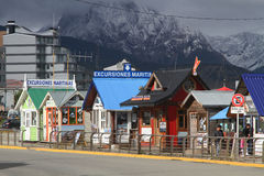 Excursions houses in Ushuaia. USHUAIA - JANUARY 2, 2014 : Excursions selling houses in the harbor of Ushuaia. Ushuaia is described as the southernmost city in Royalty Free Stock Photos