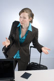 Excuse me? - Frustrated Traveler. This image shows a Young Business Woman who is a Frustrated Delayed Passenger at check-in Royalty Free Stock Photography