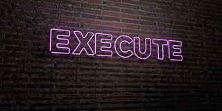 EXECUTE -Realistic Neon Sign on Brick Wall background - 3D rendered royalty free stock image Royalty Free Stock Photos