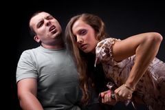 Execution. Lady trying to kill his boyfriend Stock Photography