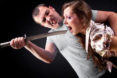 Execution. Angry man wants to kill his girlfriend Stock Photos