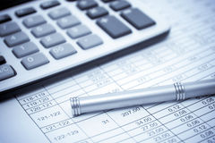 Execution mathematical and financial calculation. Calculator and pen on table in selenium tone royalty free stock photos