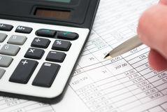 Execution mathematical and financial calculation. Pen in hand royalty free stock photos
