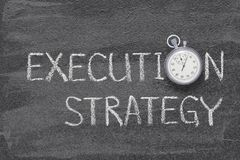 Execution strategy watch. Execution strategy phrase written on chalkboard with vintage precise stopwatch royalty free stock photo