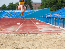 Execution of the triple jump. Sports background stock photography