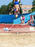 Execution of the triple jump. Sports background stock image