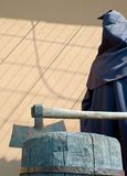 Executioner. On a scaffold. Waxen figure. Shallow DOF, focus on axe Royalty Free Stock Image
