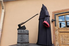 Executioner At Block With Axe Royalty Free Stock Photography