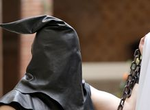 Executioner with black hood on his head and the chain Stock Images