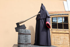 Executioner at block with axe Stock Image