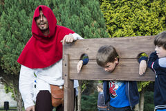 Executioner and child Stock Images