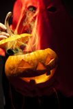 Executioner with halloween  pumpkin Stock Photo