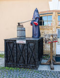 He executioner mannequin and the scaffold by the Museum of the medieval torture instruments. Stock Photos