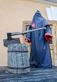 The executioner mannequin and the scaffold by the Museum of the medieval torture instruments. Stock Photos