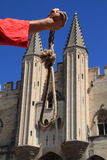 Executioner with a noose. The executioner shows the noose in front of the Palace of the Popes of Avignon (France), the ancient seat of the Sacred Roman Rota royalty free stock photos