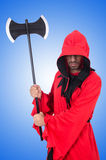 Executioner in red costume with axe on white Royalty Free Stock Photography