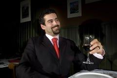 Executive. A young executive man celebrating with red wine stock photos