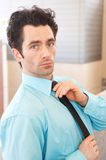 Executive adjusting his tie outside Royalty Free Stock Images