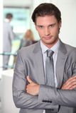 Executive with arms crossed Royalty Free Stock Images