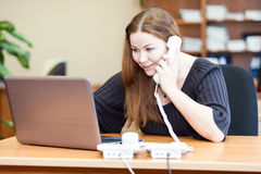 Attractive business woman making telephone calls Stock Photography