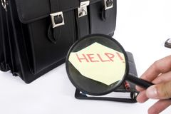 Executive bag and magnifier Royalty Free Stock Image