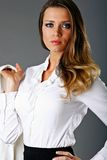 Executive beauty. Beautiful well dressed businesswoman holds her jacket Royalty Free Stock Photography