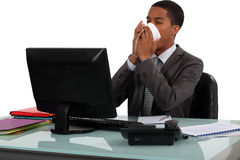 Executive blowing his nose Royalty Free Stock Photos