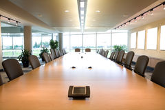Executive boardroom head view in clean office. Royalty Free Stock Images