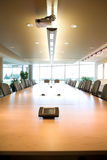 Executive boardroom head view in clean office. Portrait head front view of executive boardroom in corporate modern day clean office. Blank posters on walls that Stock Photo