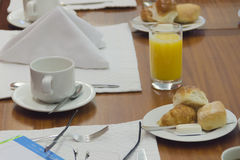 Executive breakfast. Coffee cups and small breads with butter for the afternoon meeting Royalty Free Stock Photography