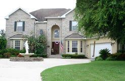 Executive Brick Home. Executive gray and white brick home, with Stock Image