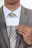 Executive with a  business card. Executive with a blank business card Royalty Free Stock Photo