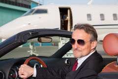 Executive business man in a cabriolet in front of corporate priv Royalty Free Stock Photo