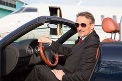 Executive business man in a cabriolet in front of corporate priv Stock Photo