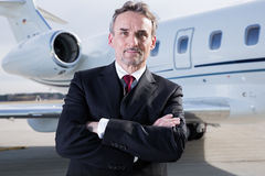Executive business man in front of corporate jet Stock Image