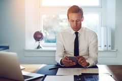 Executive business man texting on his phone Stock Photo