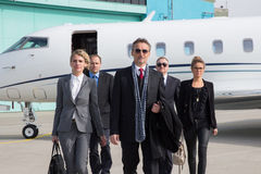 Executive business team leaving corporate jet Royalty Free Stock Photos