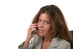 Executive Business Woman with Cellphone 2. Attractive and beautiful executive business woman talking on cellphone Stock Photo