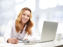 Executive business woman with laptop stock photos